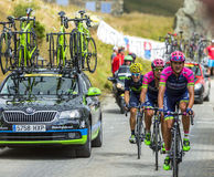 Three Cyclists in Mountains - Tour de France 2015 Stock Photos