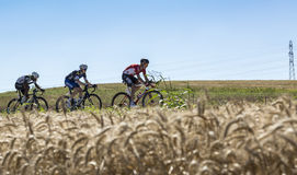Three Cyclists in the Plain - Tour de France 2016 Royalty Free Stock Photos