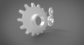 Three 3D cogs on grey gray background Stock Image