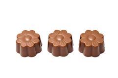 Three daisy shaped chocolate Royalty Free Stock Photos