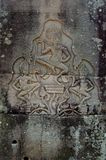 Three dancers. A trio of aspara dancers carved on a bayon tample wall angkor Stock Photography