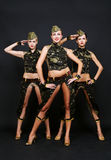 Three dancers in military uniform Royalty Free Stock Image