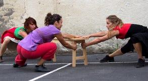 Three dancers are querelling Stock Photo
