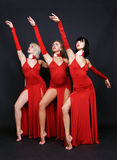 Three dancers in red evening gown Royalty Free Stock Photos
