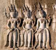 Three dancing apsara on the wall in Angkor Wat Stock Image
