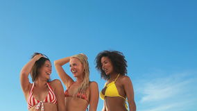 Three dancing friends in their bikinis Royalty Free Stock Photo