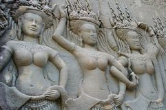 Three dancing ladies. The carved apsara female dancers on a cambodia temple of angkor Stock Photography