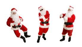 Three Dancing Santas royalty free stock image