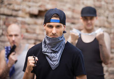 Three dangerous gangster standing outside. Stock Images