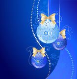 Three dark blue balls. Decorated by an original pattern, blue transparent new-year ball and two dark blue ball on a dark blue background with snowflakes Royalty Free Stock Images