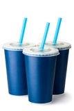 Three dark blue cardboard cups with a straws Stock Photography
