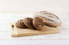 Three dark buns with caraway seeds Royalty Free Stock Image
