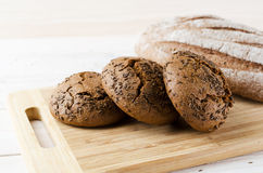 Three dark buns with caraway seeds Stock Photography