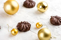 Three dark chocolate-coated zefir top view isolated on white background airy with christmas ornaments royalty free stock photography