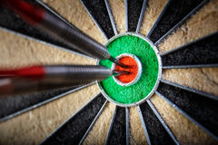 Three darts in bull`s eye Royalty Free Stock Images