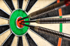Three darts in bull`s eye Royalty Free Stock Photos