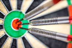 Three darts in bull`s eye Stock Photography