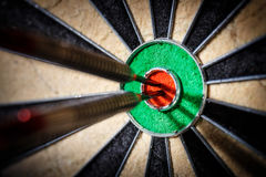 Three darts in bull`s eye Stock Images
