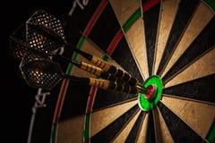 Three darts in bull's eye close up. Success hitting target aim goal achievement concept background - three darts in bull's eye close up Stock Photography