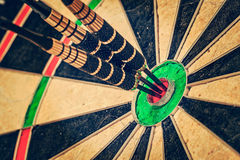 Three darts in bull's eye close up Stock Photos