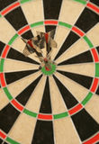 Three darts in bullseye Royalty Free Stock Photo