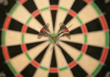 Three darts in bullseye Royalty Free Stock Photography