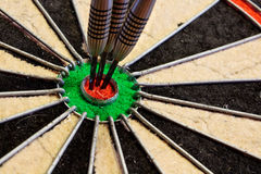 Three Darts in bullseye. Three darts in the bullseye scoring one hundred and fifty in darts tournament Royalty Free Stock Image