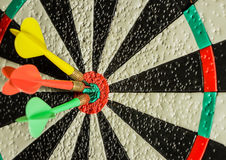 Three darts in the center of the target Stock Image