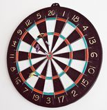 Three darts in the dartboard Stock Image