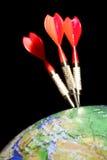Three darts in a globe royalty free stock image