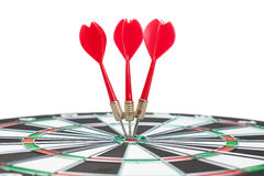 Three darts hit dead centre of target Royalty Free Stock Photography