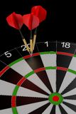 Three darts hitting the perfect score Stock Images