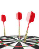 Three darts stuck in a board, top view Royalty Free Stock Photos