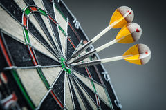 Three darts in the target Stock Images