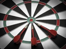 Dartboard. Three darts on the target center of dartboard Stock Images