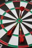 Dartboard. Three darts on the target center of dartboard Royalty Free Stock Photo