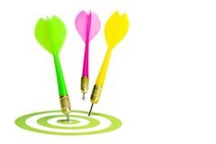 Three darts and a target. Isolated on white. Royalty Free Stock Photos