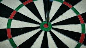 Bulls eye. Three darts thrown at the bulls eye of a dartboard stock video footage