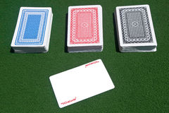 Three decks of cards with a joker. Shot of three complete different-color poker cards decks with a red joker Stock Photography