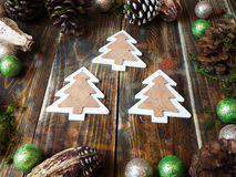 Three deco trees on a wooden table royalty free stock photos