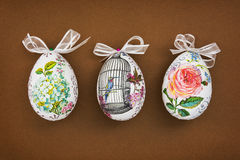Three decorated Easter eggs on the brown paper Stock Photos