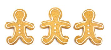 Three Decorated Gingerbread Men on a White Background. A Line of Three Decorated Gingerbread Men on a White Background royalty free stock photo