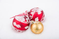 Three decoration balls on snow Royalty Free Stock Photography