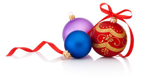 Three decorations Christmas ball with ribbon bow isolated on whi Royalty Free Stock Images