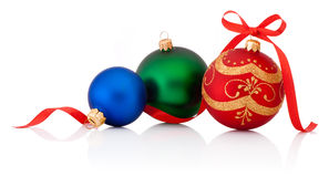 Three decorations Christmas ball with ribbon bow isolated Royalty Free Stock Photo