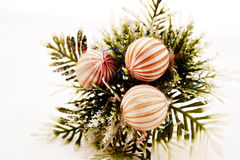 Three Decorative Baubles On Sprig Of Leaves Royalty Free Stock Images