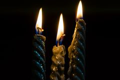 Three decorative candles in flames.  Royalty Free Stock Photos