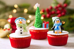 Three decorative christmas cupcakes with tradition background. Three christmas cupcakes with tradition background Royalty Free Stock Photos