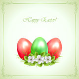 Three decorative Easter eggs on green background Stock Image