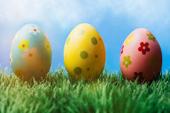 Three decorative easter eggs in a row Stock Photos